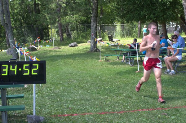 Hegge crossing the finish of the Voyageur 50 Mile in first place